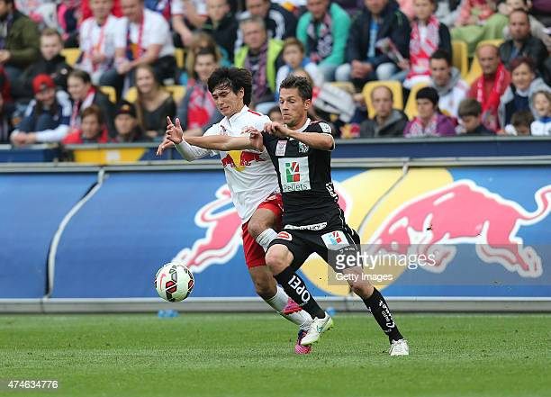 Takumi Minamino of Salzburg and Rene Seebacher of Wolfsberg fight for the ball during the tipico Bundesliga match between RB Salzburg and Wolfsberger...