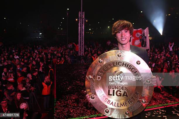 Takumi Minamino of Salzburg celebrates with the trophy for winning the Austrian Soccer Championship after the tipico Bundesliga match between RB...