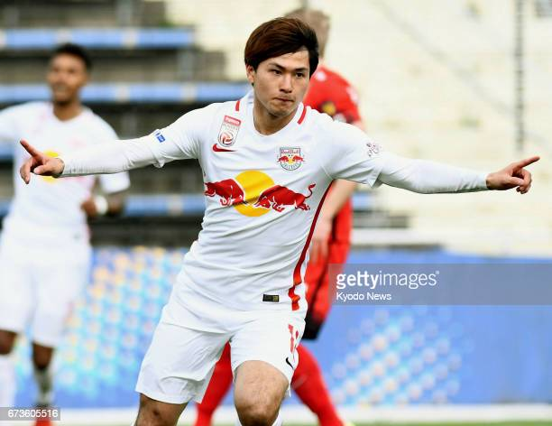 Takumi Minamino reacts after opening the scoring in the first half of Salzburg's 50 victory away to Admira in the semifinals of the Austrian Cup on...