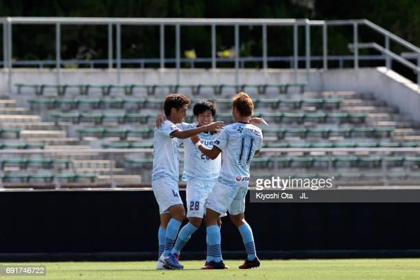 Takumi Nagura of FC Ryukyu celebrates scoring his side's second goal with his team mates Yutaro Chinen and Ryuji Saito during the JLeague J3 match...