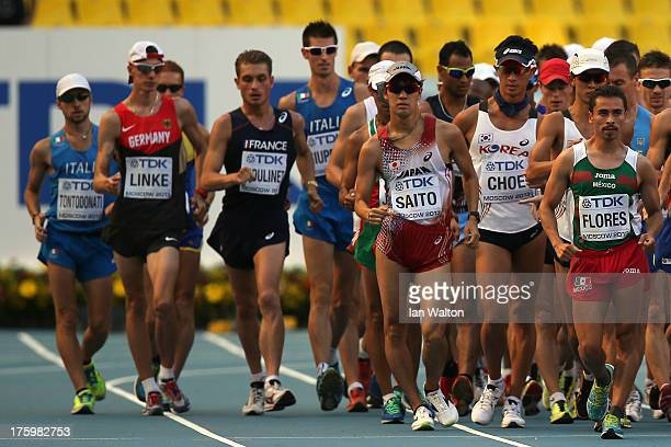 Takumi Saito of Japan and Diego Flores of Mexico competes in the Men's 20km Race Walk final during Day Two of the 14th IAAF World Athletics...