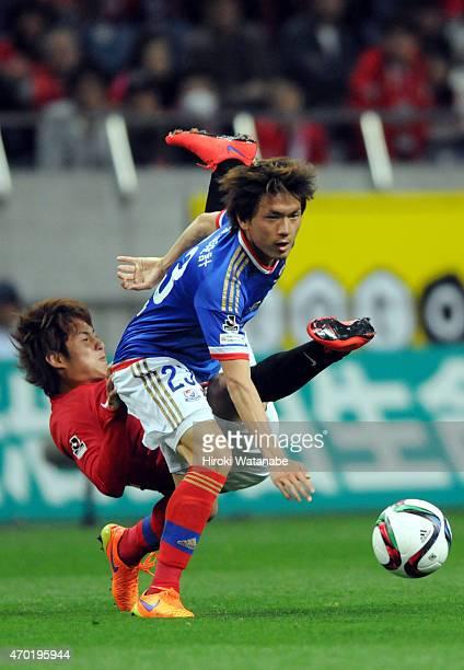 Takumi Shimohira of Yokohama FMarinos and Takahiro Sekine of Urawa Red Diamonds compete for the ball during the JLeague match between Urawa Red...