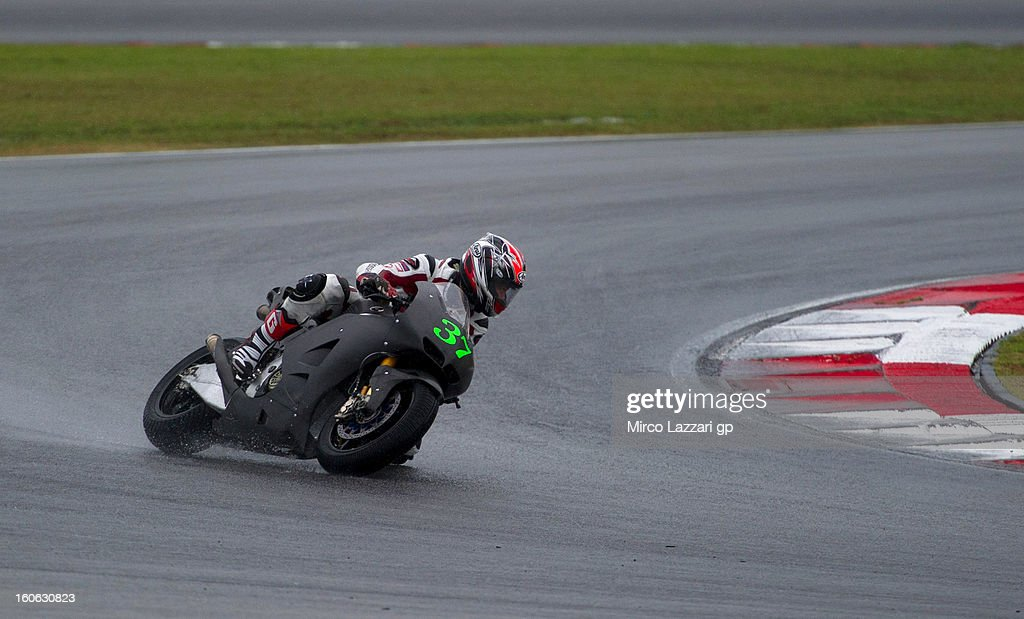 Takumi Takahashi of Japan and HRC rounds the bend during the MotoGP - CRT Tests in Sepang - Day Two at Sepang Circuit on February 4, 2013 in Kuala Lumpur, Malaysia.