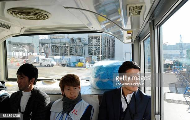 Takumi Watanabe of Fukushima United Shota Kaneko of Shimizu SPulse and Daiki Iwamasa of Fagiano Okayama inspect Tokyo Electric Power Co's Fukushima...