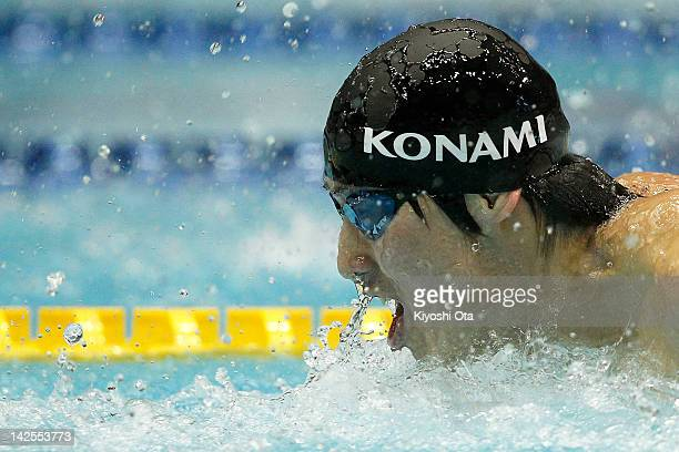 Takuro Fujii competes in the Men's 100m Butterfly semi final during day six of the Japan Swim 2012 at Tokyo Tatsumi International Swimming Pool on...