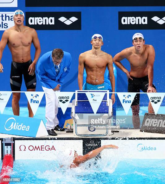Takuro Fujii Ryosuke Irie Yasuhiro Koseki and Shinri Shioura of Japan react after the Men's 4x100 Medley Relay final on day sixteen of the 16th FINA...