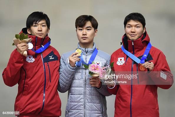 Takuro Oda of Japan MinSeok Kim of South Korea and Taro Kondo of Japan pose on the podium during award ceremony for the speed skating mens 1500m on...