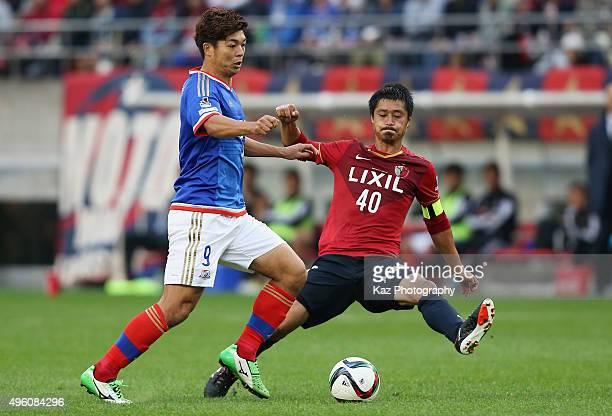 Takuro Yajima of Yokohama FMarinos and Mitsuo Ogasawara of Kashima Antlers compete for the ball during the JLeague match between Kashima Antlers and...