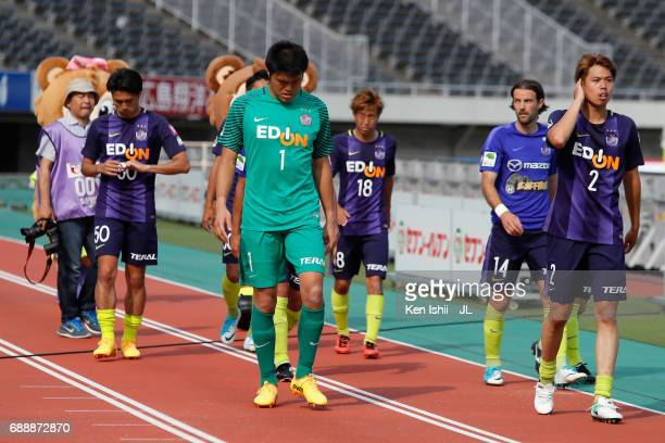 Takuto Hayashi and Sanfrecce Hiroshima players show dejection after the scoreless draw in the JLeague J1 match between Sanfrecce Hiroshima and Jubilo...