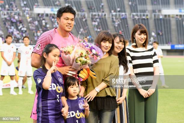 Takuto Hayashi of Sanfrecce Hiroshima attends a ceremony to mark his 250th appearance in the J1 with his wife and children prior to the JLeague J1...