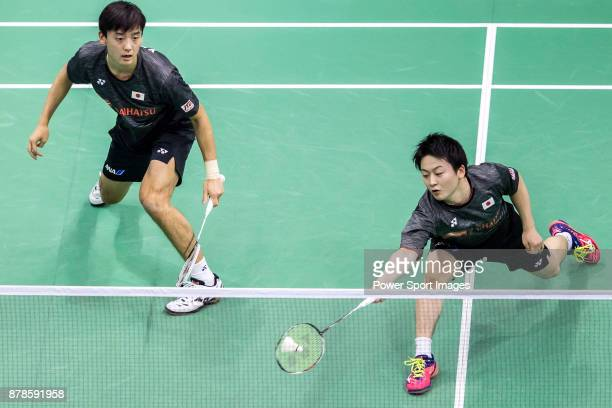 Takuto Inoue and Yuki Kaneko of Japan compete against Mark Lamsfuss and Marvin Emil Seidel of Germany during their men doubles round 32 match of the...