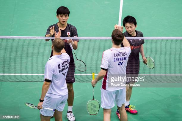 Takuto Inoue and Yuki Kaneko of Japan shake hands with Mark Lamsfuss and Marvin Emil Seidel of Germany after their men doubles round 32 match of the...