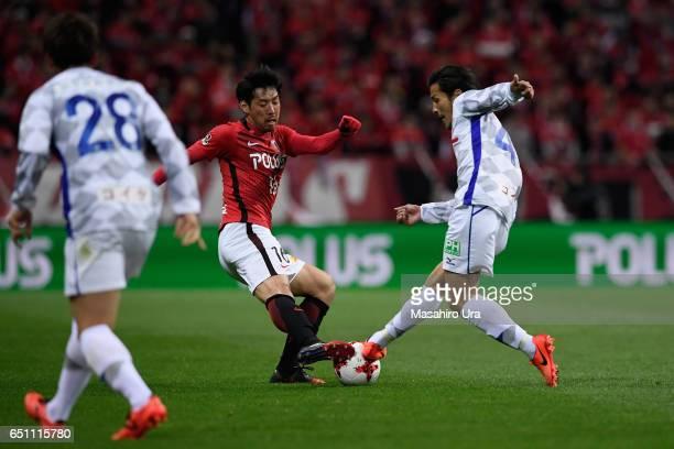 Takuya Aoki of Urawa Red Diamonds and Shohei Ogura of Ventforet Kofu compete for the ball during the JLeague J1 match between Urawa Red Diamonds and...