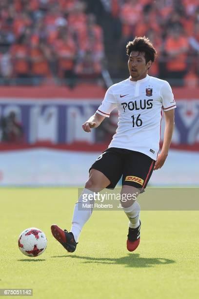 Takuya Aoki of Urawa Red Diamonds passes the ball during the JLeague J1 match between Omiya Ardija and Urawa Red Diamonds at Nack 5 Stadium Omiya on...