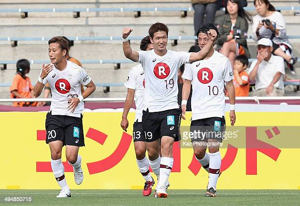Takuya Iwanami of Vissel Kobe celebrates scoring his team's second goal with his teammates during the JLeague Yamazaki Nabisco Cup Group A match...