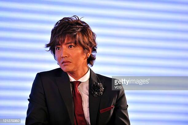 Takuya Kimura member of Japanese boy band SMAP attends a press conference to promote their Beijing concert at Westin Hotel on August 16 2011 in...