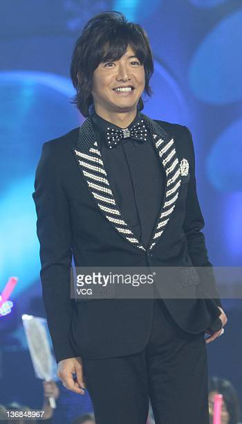 Takuya Kimura of Japanese boy group SMAP perform on stage for Dragon TV Lunar New Year Gala on January 11 2012 in Shanghai China