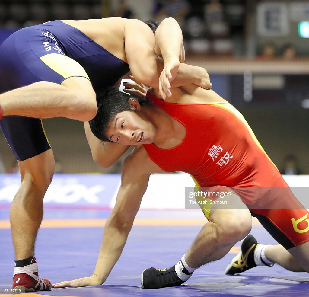 Takuya Maeta (red) and Ryusuke Kobayashi (blue) compete in the Men's Greco-Roman -80kg final during day one of the All Japan Wrestling Invitational Championships at the Yoyogi National Gymnasium on May 27, 2016 in Tokyo, Japan.