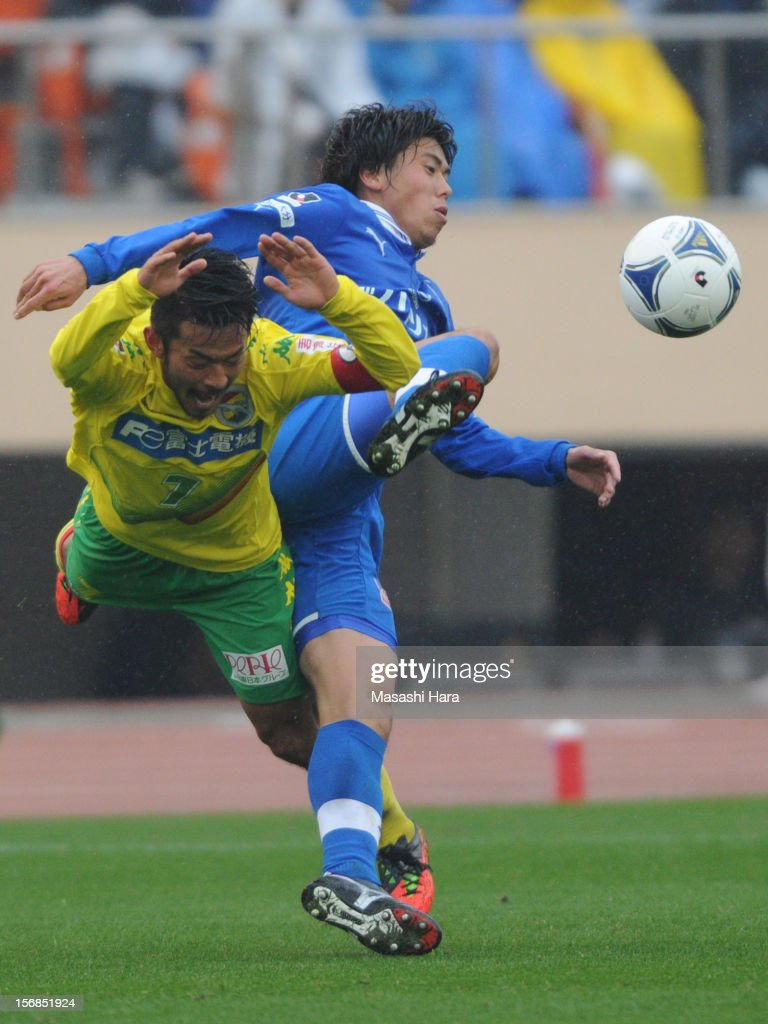 Takuya Marutani #33 of Oita Trinita (R) and Yuto Sato #7 of JEF United Chiba compete for the ball during the J.League Second Division Play-off Final match between JEF United Chiba and Oita trinita at the National Stadium on November 23, 2012 in Tokyo, Japan.