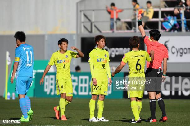 Takuya Marutani of Sanfrecce Hiroshima receives the red card after two yellow cards by referee Futoshi Nakamura during the JLeague J1 match between...