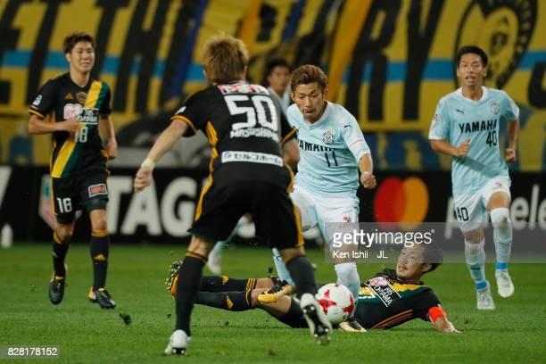 Takuya Matsuura of Jubilo Iwata and Shingo Tomita of Vegalta Sendai compete for the ball during the JLeague J1 match between Vegalta Sendai and...