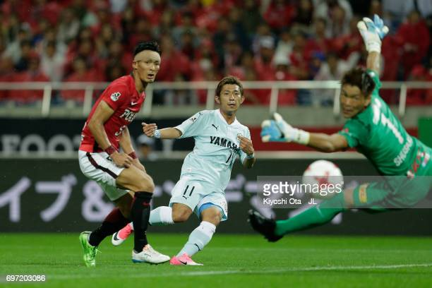 Takuya Matsuura of Jubilo Iwata scores his side's fourth goal past Shusaku Nishikawa of Urawa Red Diamonds during the JLeague J1 match between Urawa...