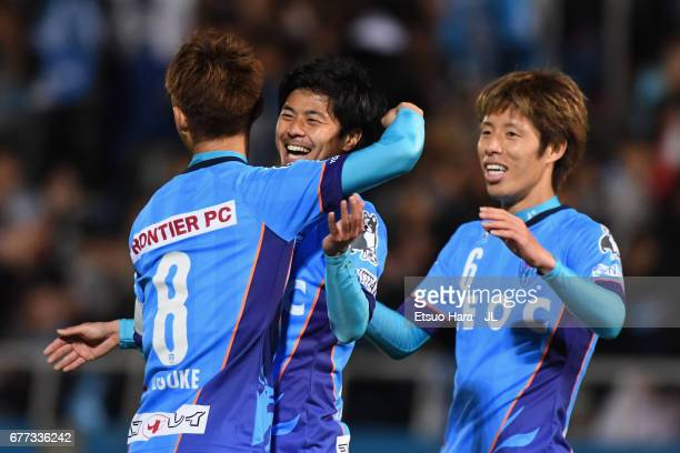 Takuya Nagata of Yokohama FC celebrates scoring his side's third goal with his team mates Kensuke Sato and Takahiro Nakazato during the JLeague J2...