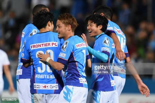 Takuya Nagata of Yokohama FC celebrates scoring his side's third goal with his team mates during the JLeague J2 match between Yokohama FC and Ehime...