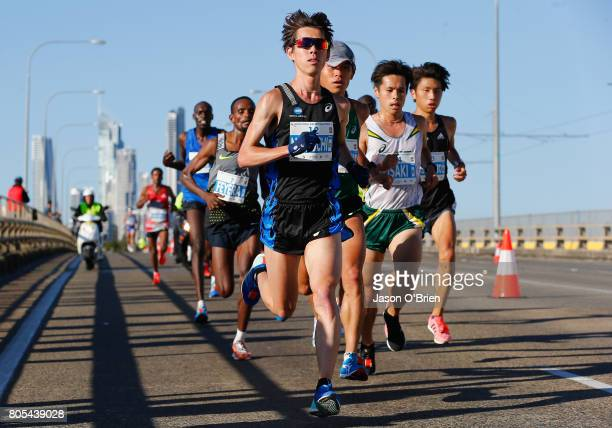 Takuya Noguchi from Japan leads the pack during the Gold Coast Marathon on July 2 2017 in Gold Coast Australia