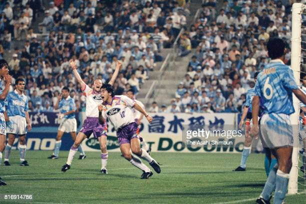 Takuya Takagi of Safrecce Hiroshima heads the ball to score his side's first goal during the JLeague match between Jubilo Iwata and Sanfrecce...