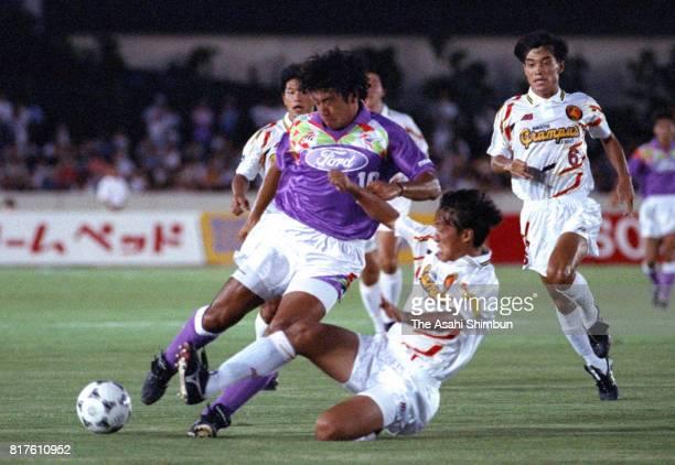 Takuya Takagi of Sanfrecce Hiroshima and Hisataka Fujikawa of Nagoya Grampus Eight compete for the ball during the JLeague match between Sanfrecce...