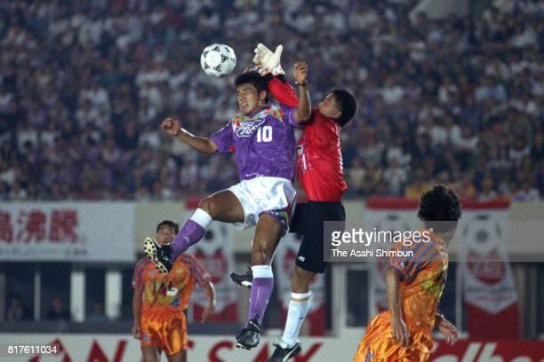 Takuya Takagi of Sanfrecce Hiroshima and Masanori Sanada of Shimizu SPulse compete for the ball during the JLeague match between Sanfrecce Hiroshima...