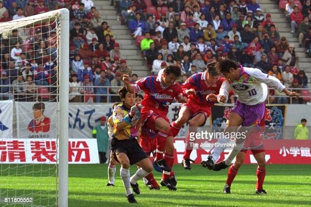 Takuya Takagi of Sanfrecce Hiroshima heads to score the opening goal during the JLeague match between Kashima Antlers and Sanfrecce Hiroshima at...