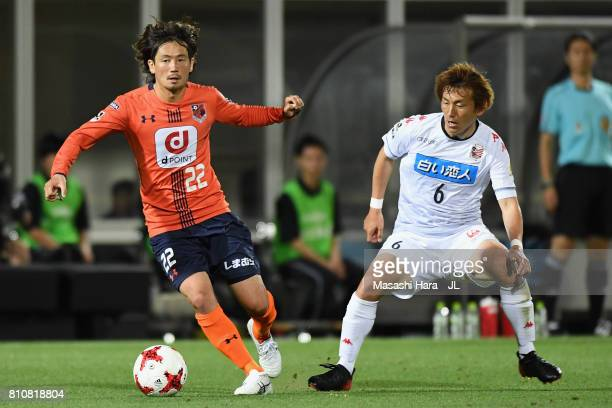 Takuya Wada of Omiya Ardija and Shingo Hyodo of Consadole Sapporo compete for the ball during the JLeague J1 match between Omiya Ardija and Consadole...