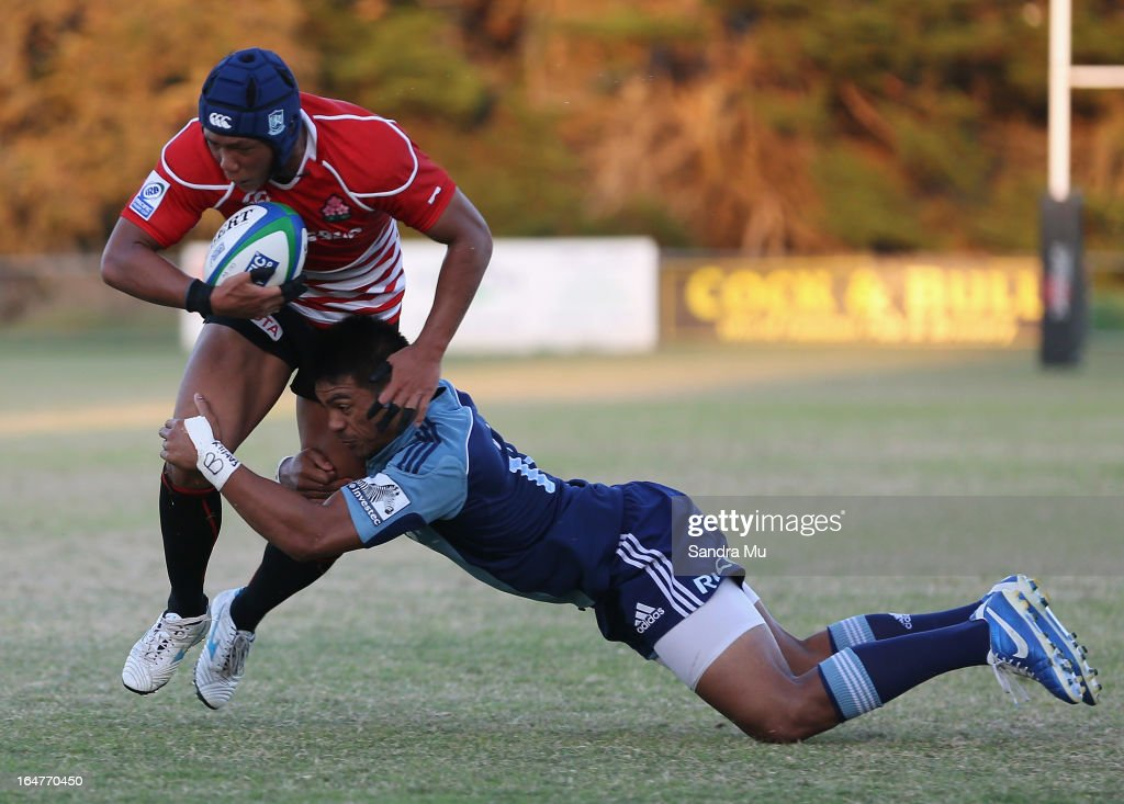 Takuya Yamasawa of Japan is tackled during the Pacific Rugby Cup match between the Blues Development and Junior Japan at Bell Park on March 28, 2013 in Auckland, New Zealand.