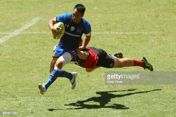 Takuya Yamasawa of the Panosonic Wild Knights is tackled during the Rugby Global Tens match between Wild Knights and Crusaders at Suncorp Stadium on...