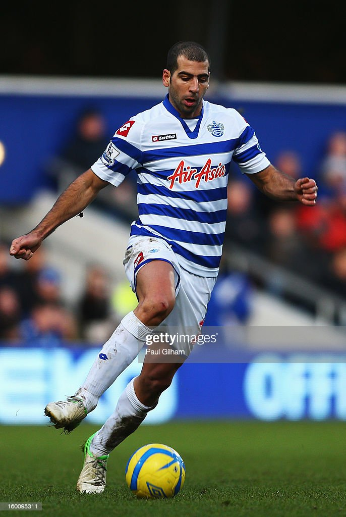 Tal Ben Haim of Queens Park Rangers runs with the ball during the FA Cup with Budweiser Fourth Round match between Queens Park Rangers and Milton Keynes Dons at Loftus Road on January 26, 2013 in London, England.