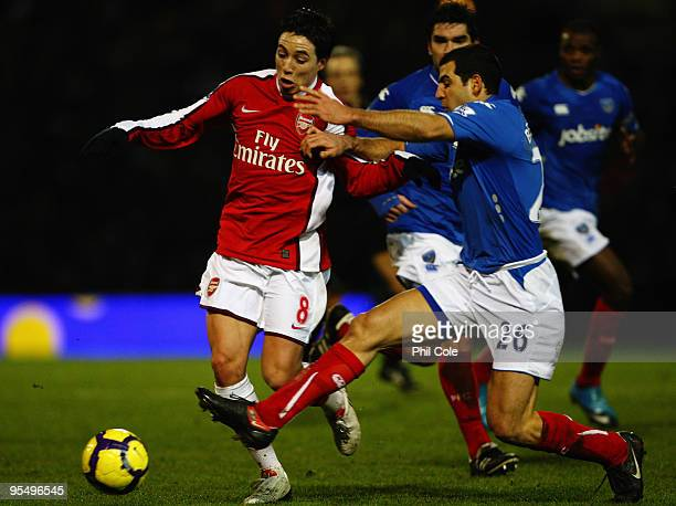 Tal BenHaim of Portsmouth challenges Samir Nasri of Arsenal during the Barclays Premier League match between Portsmouth and Arsenal at Fratton Park...