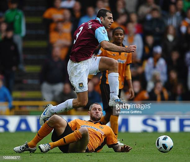 Tal BenHaim of West Ham battles jumps over Jelle Van Damme of Wolves during the Barclays Premier League match between Wolverhampton Wanderers and...