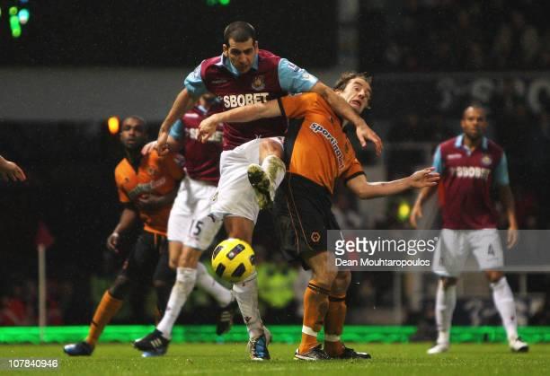 Tal BenHaim of West Ham United challenges Stephen Hunt of Wolverhampton Wanderers during the Barclays Premier League match between West Ham United...