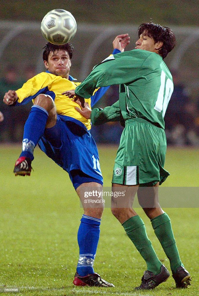 Tal Idan of Maccabi fights for the ball with Robert Koren of Publikum during their UEFA match in Celje Slovenia 15 October 2003 AFP PHOTO STRINGER