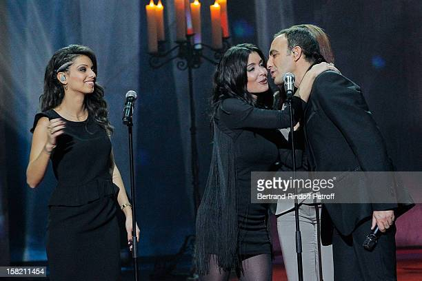 Tal Jenifer Amel Bent and TV host Nikos Aliagas perform during 'La Chanson De L'Annee 2012' Show Recording at Palais des Sports on December 10 2012...