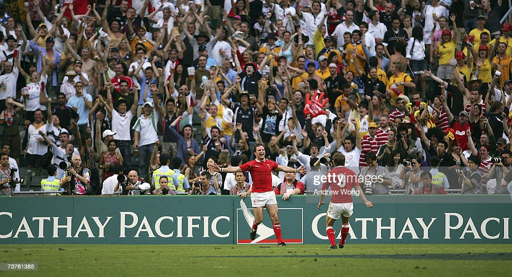 Tal Selley of Wales celebrates with team mate Wayne Evans after scoring the winning try against Argentina during their Plate Final at the Cathay...