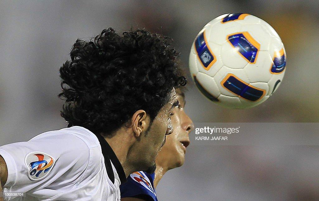 Talal Al Bloshi of Qatar's Al-Sadd club (L) challenges Oh Bemo Seok of South Korea's Suwon Samsung Bluewings during their AFC Champions League semi-final football match at Al-Sadd stadium in Doha, on October 26, 2011. Suwon won 1-0.
