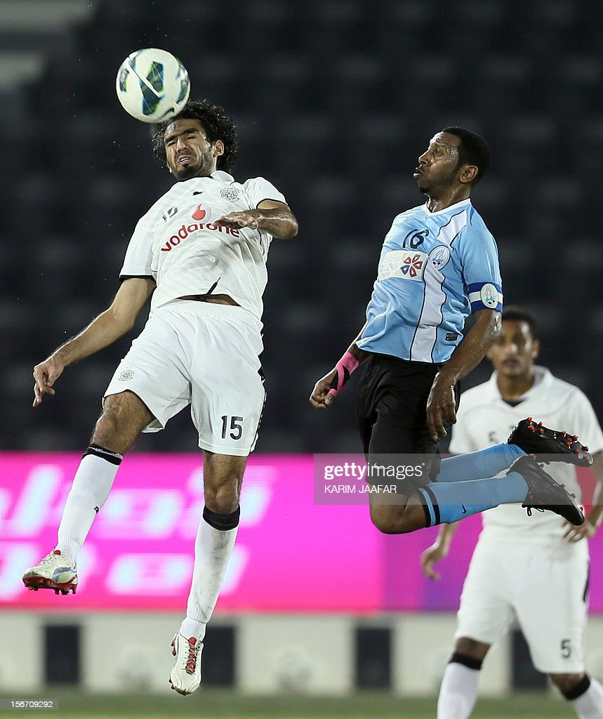 Talal Al-Bloshi of Qatar's Al-Sadd (L) fights for the ball against Nayef Al-Khatter (R) of Al-Wakra during their Qatar Stars League football match in Doha on November 19, 2012. Al-Sadd won 2-1. AFP PHOTO/ AL-WATAN DOHA /KARIM JAAFAR== QATAR OUT ==