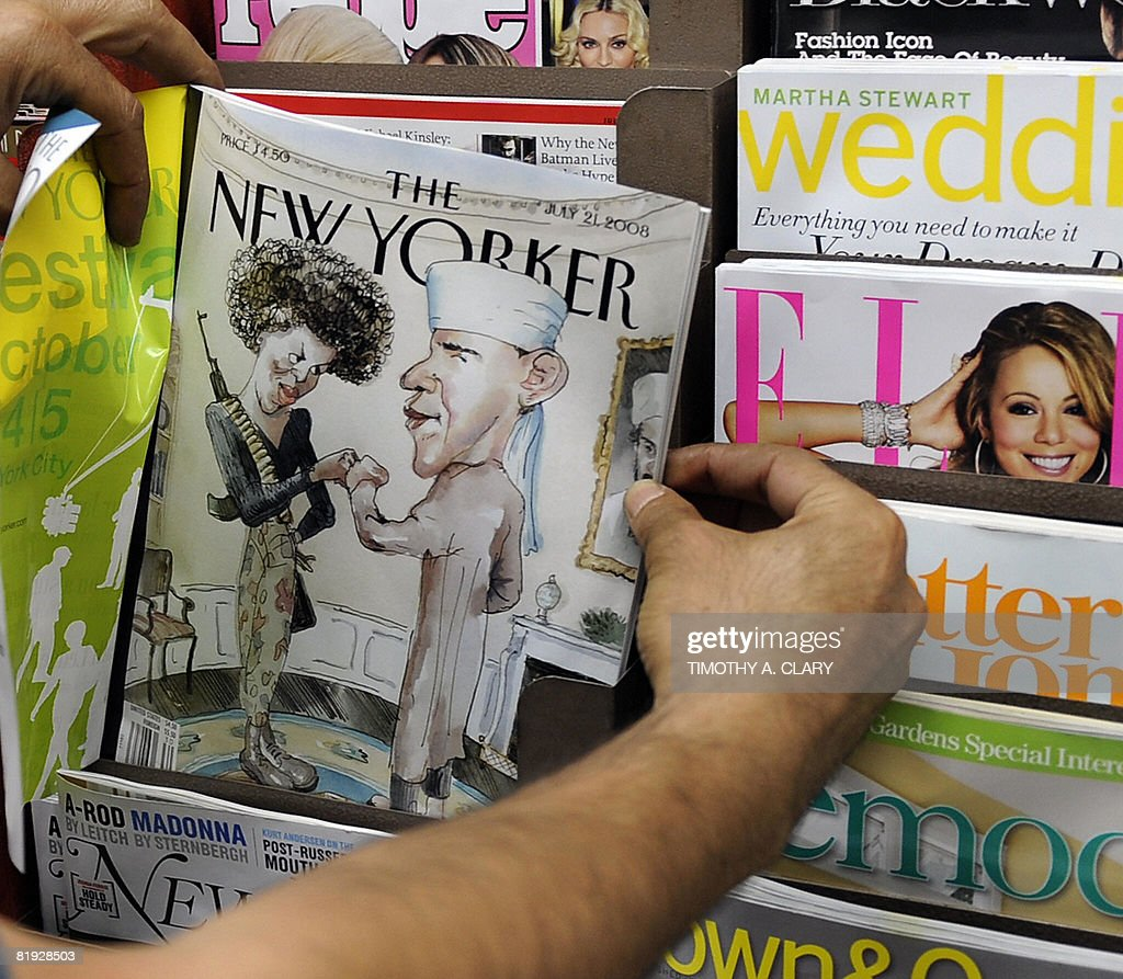 Taleb Alkardai holds up a copy of the New Yorker magazine cover showing Democratic presidential candidate Barack Obama dressed as a Muslim and his wife as a terrorist at his midtown newstand on July 14, 2008 in New York. Barack Obama's campaign called the magazine illustration, that hits newsstands today, as 'tasteless and offensive.'