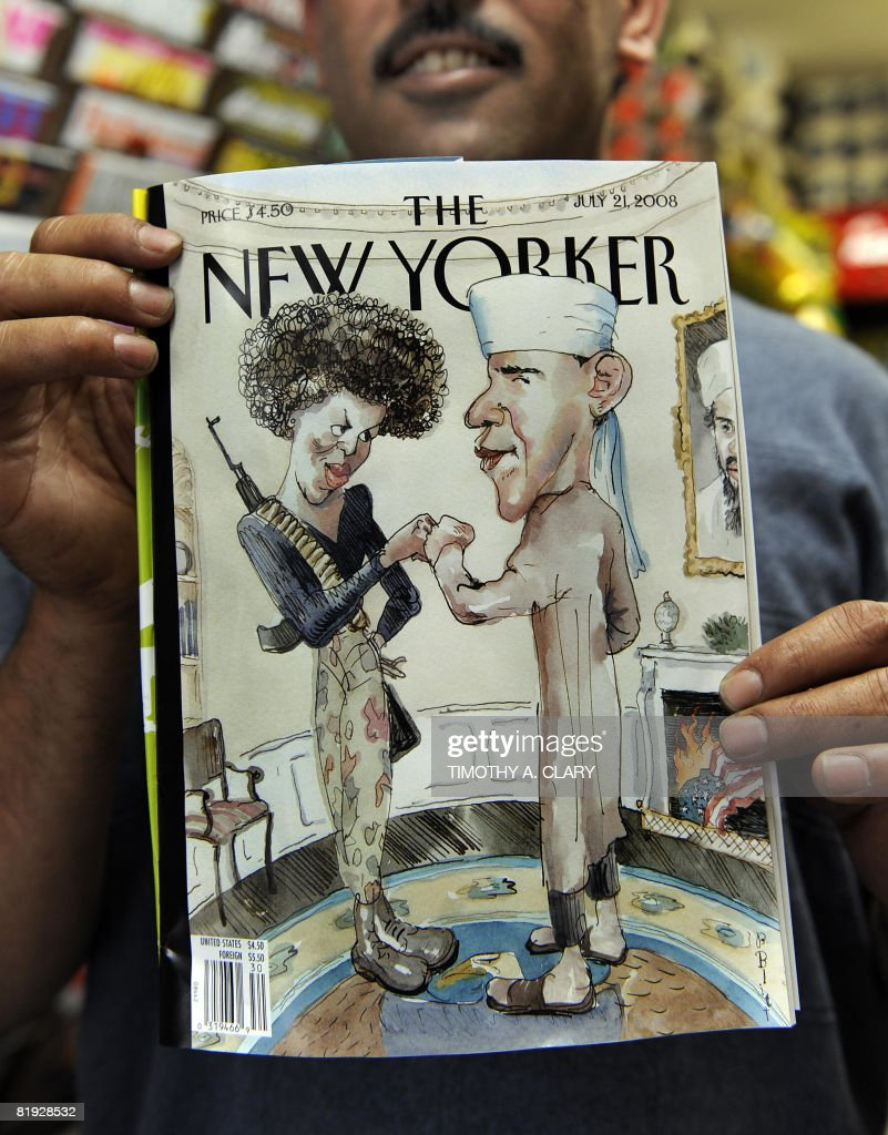 Taleb Alkardai holds up a copy of the New Yorker magazine cover showing Democratic presidential candidate Barack Obama dressed as a Muslim and his wife as a terrorist at his midtown newstand July 14, 2008. Barack Obama's campaign called the magazine illustration, that hits newsstands today, as 'tasteless and offensive.'