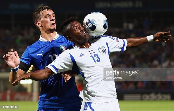 Taleb Twatha of Israel is challenged by Manolo Gabbiadini of Italy during the UEFA European U21 Championship Group A match between Italy and Israel...