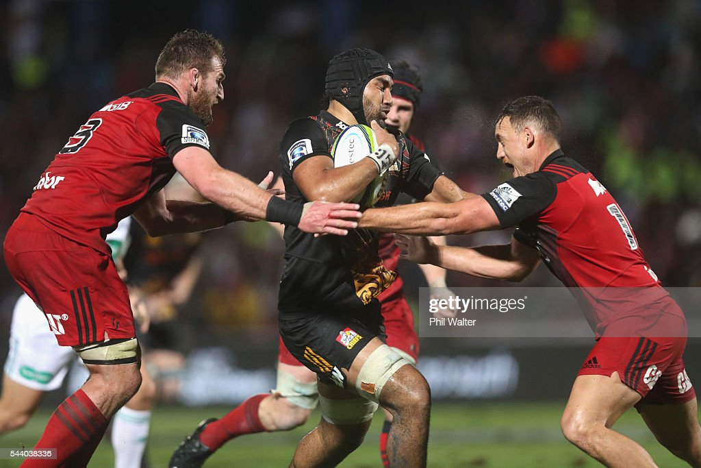 Taleni Seu of the Chiefs fends away <a gi-track='captionPersonalityLinkClicked' href=/galleries/search?phrase=Israel+Dagg&family=editorial&specificpeople=2086281 ng-click='$event.stopPropagation()'>Israel Dagg</a> and <a gi-track='captionPersonalityLinkClicked' href=/galleries/search?phrase=Kieran+Read&family=editorial&specificpeople=789465 ng-click='$event.stopPropagation()'>Kieran Read</a> of the Crusaders during the round 15 Super Rugby match between the Chiefs and the Crusaders at ANZ Stadium on July 1, 2016 in Suva, Fiji.