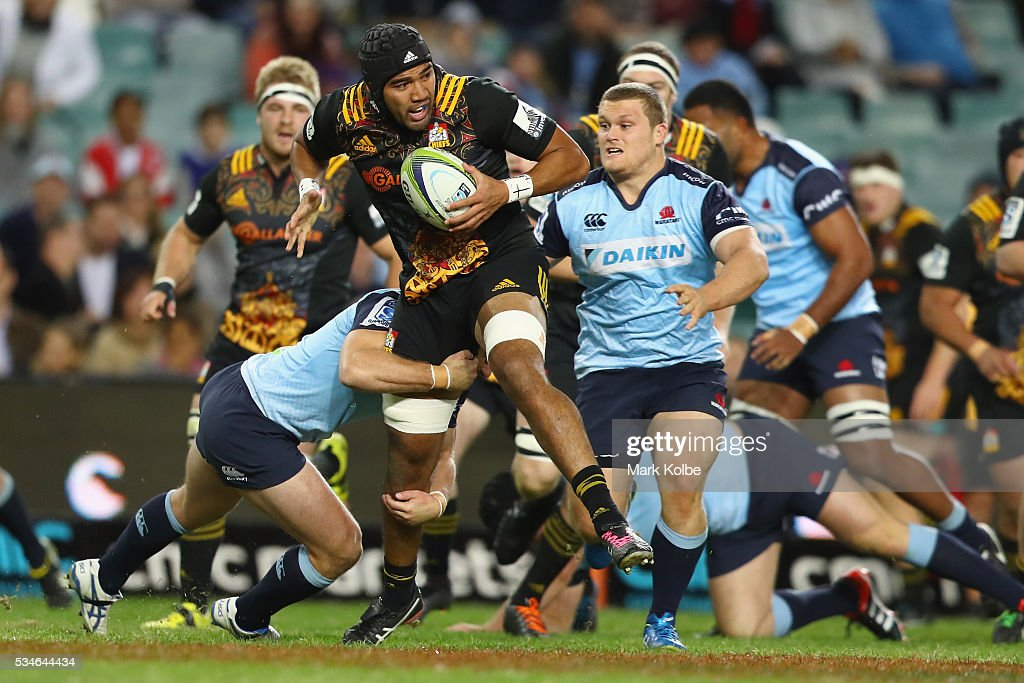 Taleni Seu of the Chiefs is tackled during the round 14 Super Rugby match between the Waratahs and the Chiefs at Allianz Stadium on May 27, 2016 in Sydney, Australia.